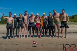Ten swimmers who completed a swim as a gift for the 100th anniversary of Latvia