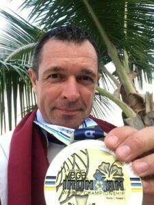 Dzintars with the finisher medal of Ironman WC 2019