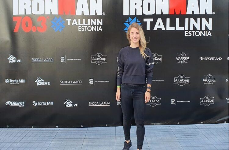 Triathlete Lāsma Ozola by the Ironman Tallinn logo