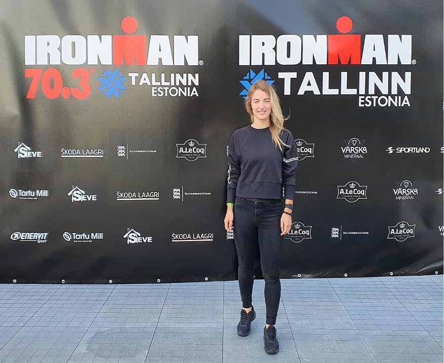 Triathlete Lāsma Ozola by the Ironman Tallinn logo
